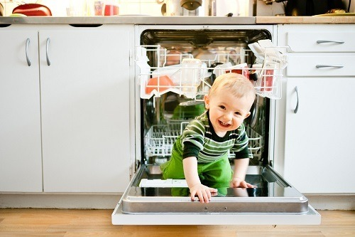 Baby Crawling On Top Of Dishwasher Door